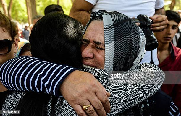 A woman is comforted during a funeral for a victim of last night's attack on a wedding party that left 50 dead in Gaziantep in southeastern Turkey...