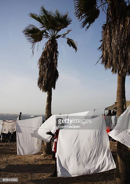 Woman is doing the laundry at a beach on the Ile De Gore island on December 27 2007 near Dakar Republic of Senegal The Ile De Gore island is situated...