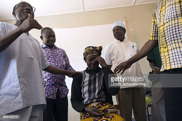 A woman is examined by an ophthalmologist and his assistants on January 25 2014 in Leo Burkina Faso The French cosmetics company L'Occitane has been...
