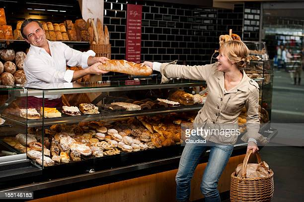 Woman is fighting with baker for her bread