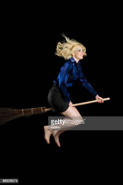 Woman is flying on broom