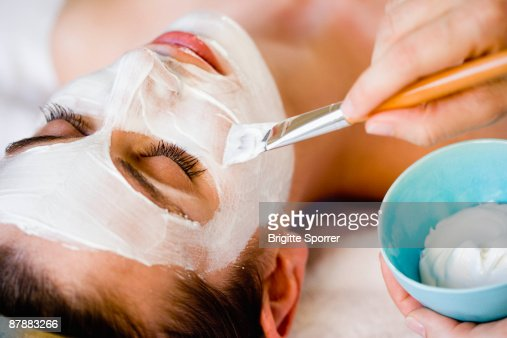 Woman is getting a face mask