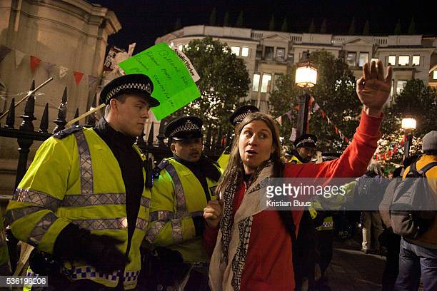 A woman is given police a hard time for their tactics The London Stock Exchange was attempted occypied in solidarity with Occupy Wall in Street in...