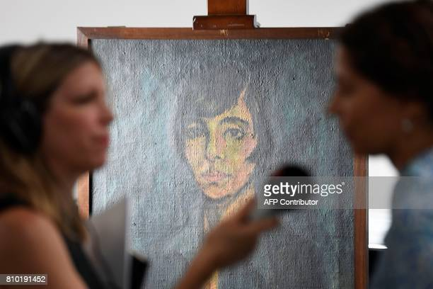 A woman is interviewed during the press preview of the first masterpieces of the estate of German collector Cornelius Gurlitt at the Museum of Fine...