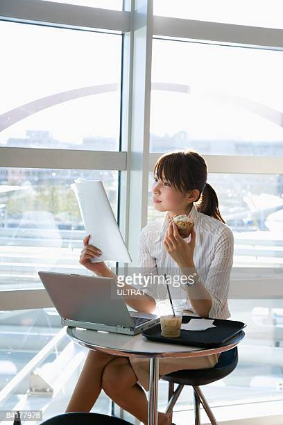A woman is looking at documents.