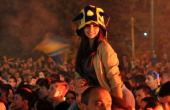 A woman is pictured as supporters of Bosnia and Herzegovina's national football team gather late on October 15 at one of city squares to watch public...