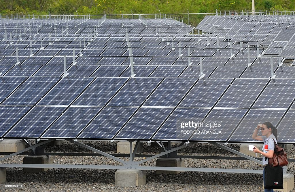 A woman is pictured at the Miravalles Solar Power Plant in Miravalles, 220 km north of San Jose, on November 22, 2012. Costa Rica inaugurated the largest plant of electricity from solar energy in Central America, which may generate 1.2 gigawats a year and was built with funds from the Japanese government. AFP PHOTO/Rodrigo ARANGUA