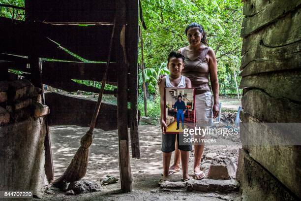 CHICHIGALPA CHINANDEGA NICARAGUA A woman is pictured with her son who holds a portrait of his father that passed away because of the epidemic kidney...