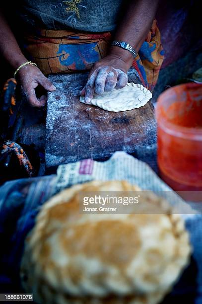 A woman is preparing local food at a food stand in Darjeeling The town lies at 2500 meters in the Himalayas in the state of West Bengal Trekking...