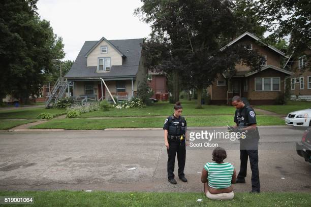 A woman is questioned following a fight outside of a suspected drug house on July 12 2017 in Rockford Illinois Rockford a city of about 150000...