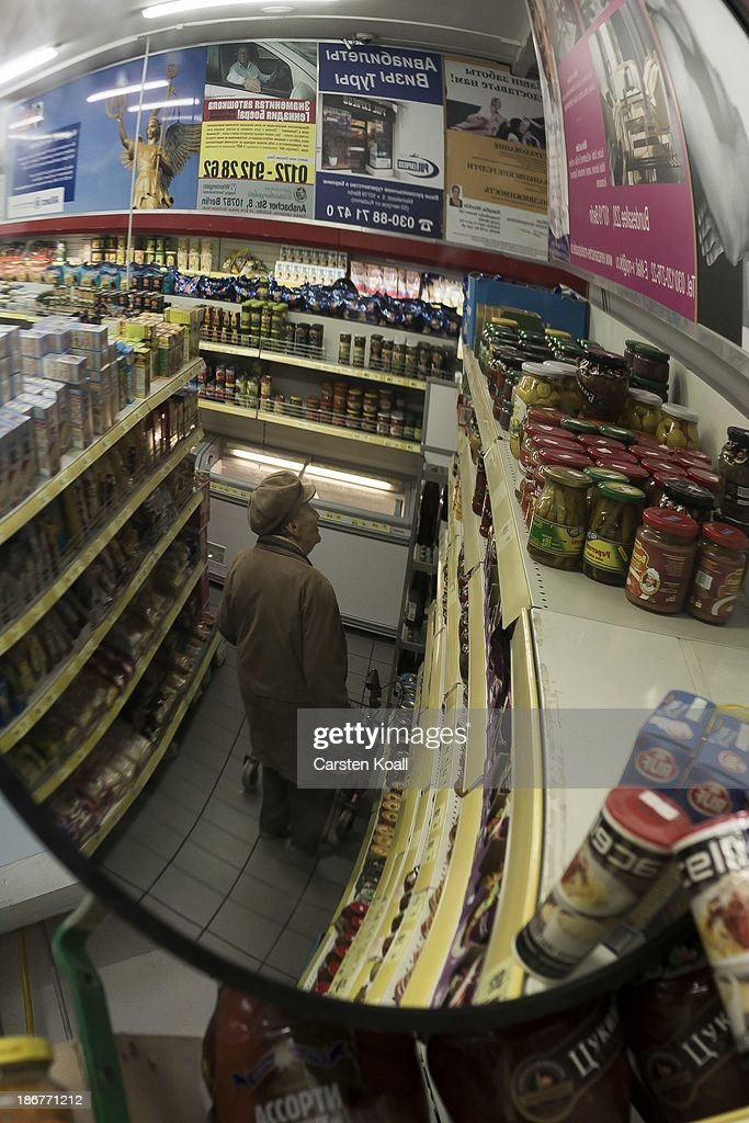 A woman is reflected in a mirror as she looks for goods in the Russian supermarket 'Rossia' in Charlottenburg district on November 03, 2013 in Berlin, Germany. According to recently published statistics, 7.2 million foreigners were living in Germany by the end of 2012, which is the highest number ever recorded. Of those 80% are from countries in the European Union, while the rest come primarily from Turkey, Russia, the former Soviet states and Arab countries.