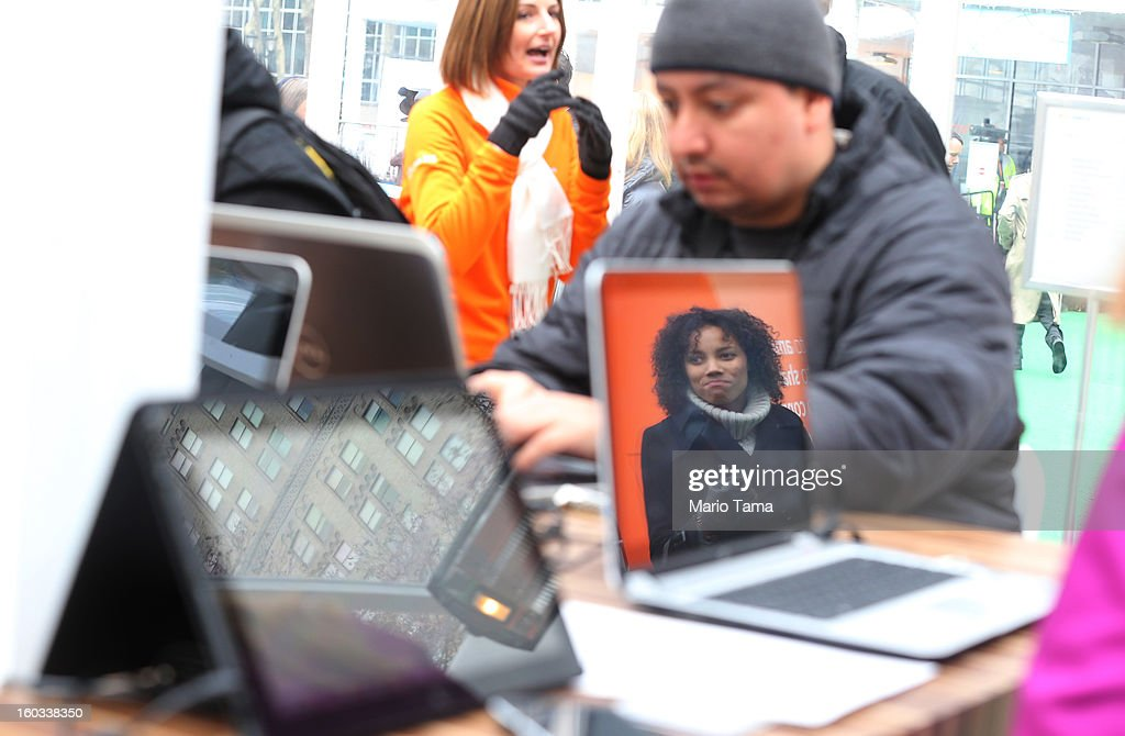 A woman is reflected in a screen as people try out devices at the Microsoft Office 2013 launch event in Bryant Park on January 29, 2013 in New York City. Microsoft is launching three versions, Office Professional 2013, Office Home & Student 2013 and Office Home & Business 2013.