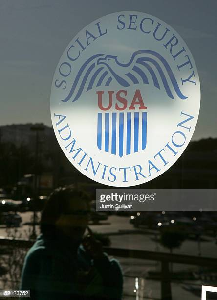 A woman is reflected in the door of the Social Security Administration office February 2 2005 in San Francisco California With an eye on his legacy...