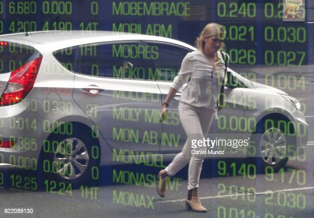 A woman is reflected on a window of the Australian Securities Exchange building on November 10 2016 in Sydney Australia Americans voted yesterday to...
