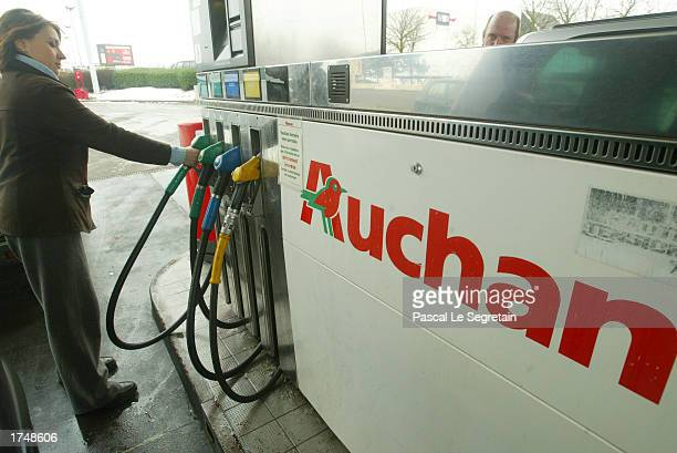 A woman is seen at the Auchan gas station January 13 2003 in Plaisir outside Paris France