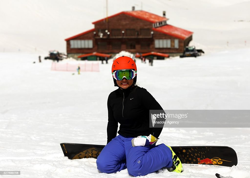 A woman is seen at the ski resorts of Alborz mountain during a competition marking the end of the winter at Tochal ski resort north of the capital Tehran, Iran on May 3, 2016.