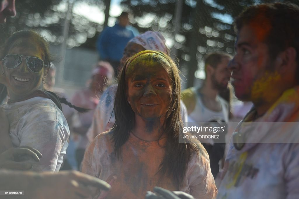 A woman is seen covered in paint powder at the end of the Kolorfest race in Guatemala City on February 17, 2013. About 1500 people participated in the event to raise money for charities. AFP PHOTO/Johan ORDONEZ