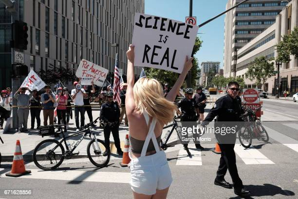 A woman is seen demonstrating in front of a small proTrump counter demonstration as scientists and supporters participate in a March for Science on...