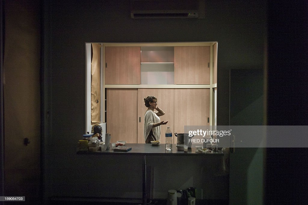 A woman is seen in a room she occupied in a building requisitioned by French associations 'Jeudi Noir' ('Black Thursday') and 'Droit Au Logement', ('Right to Housing Association', DAL), on January 6 , 2013 in Paris. The building, situated in the 10th arrondissement of Paris is occupied since December 31, 2012.