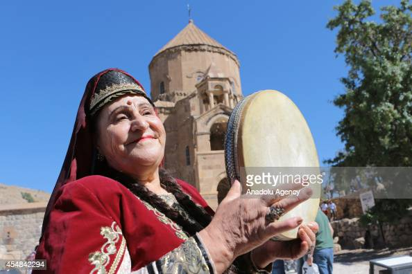 A woman is seen in front of the church during the 5th special mass in the 10thcentury Akdamar Church on September 7 in Turkey's eastern Van province...
