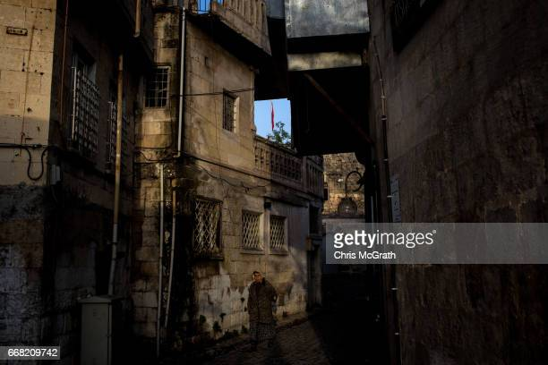 A woman is seen walking through the old city on April 13 2017 in Gaziantep Turkey Campaigning by both the 'Evet' and 'Hayir' camps has intensified...