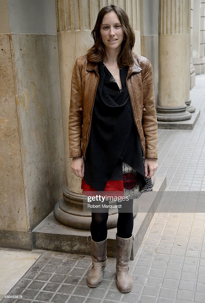 A woman is seen wearing a dress by Cache Cache, a jacket by Mundy piel and shoes by CoolWay on June 11, 2014 in Barcelona, Spain.