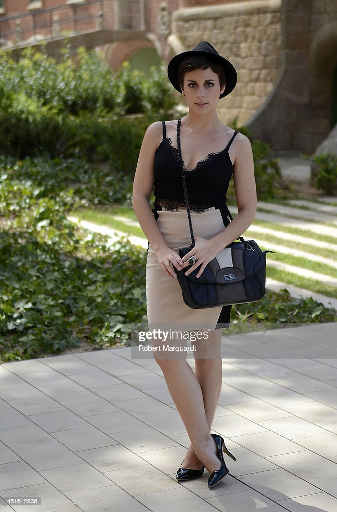 A woman is seen wearing a dress by Stradivarius with a Misako handbag and hat by H&M during the 080 Barcelona Fashion Week on July 3, 2014 in Barcelona, Spain.
