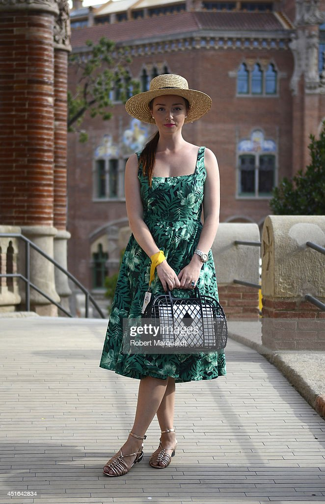 A woman is seen wearing a dress by Zara with a hat and handbag by HM during the 080 Barcelona Fashion Week on July 3 2014 in Barcelona Spain