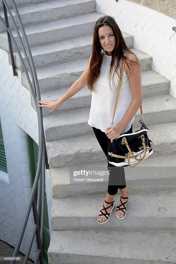 A woman is seen wearing a top by Esphera, pants by H&M, shoes by Zara and a handbag by The Sack Avenue during the 080 Barcelona Fashion Week on July 3, 2014 in Barcelona, Spain.