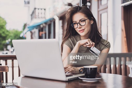 Woman is shopping online with laptop computer and credit card : Stock Photo