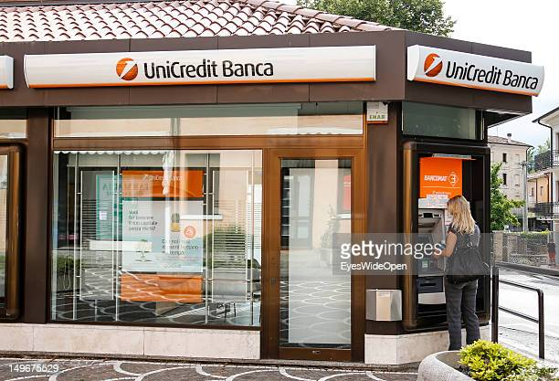 Woman is taking Euros with her credit card or Maestro EC Card from a cash machine of the UniCredit Bank in the Dolomite Alps on July 14 2012 in...