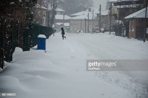 A woman is walking as snow falls at the streets of Svilengrad Bulgaria on January 11 2017 Snow paralyse Bulgaria The snow reached 40 70 sm at...