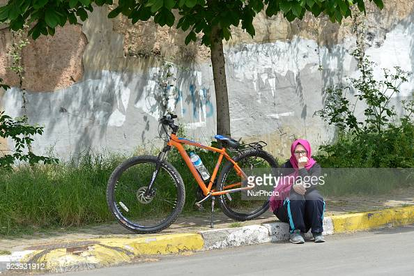 A woman is watching the opening stage of the 52nd Presidential Tour of Turkey 2016 the Spor Toto stanbul stanbul Stage Istanbul Turkey on Sunday 24...
