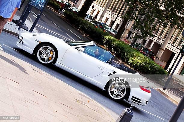 Woman is white Porsche on Königsallee