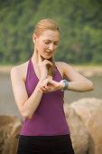 Woman jogger checking pulse
