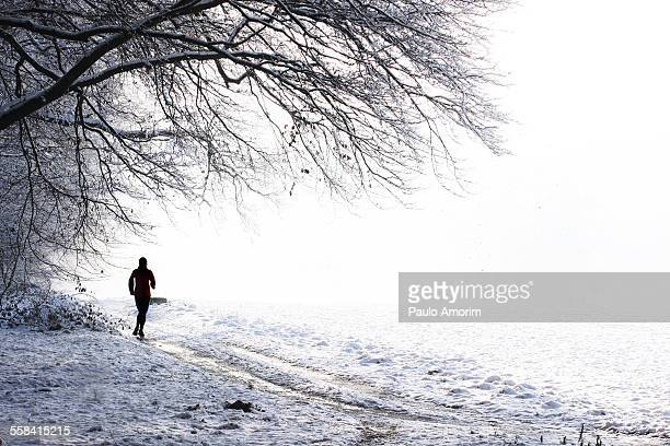 A woman jogging at park during winter