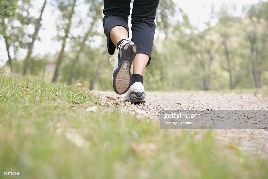 Woman jogging at park : Bildbanksbilder