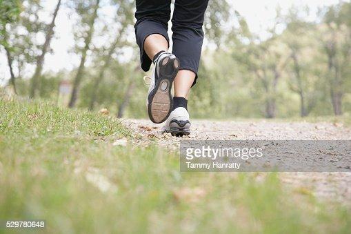 Woman jogging at park : Stockfoto