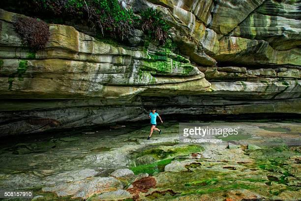 Woman Jogging by Cliffs