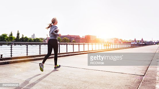Woman jogging in Berlin city : Stock Photo