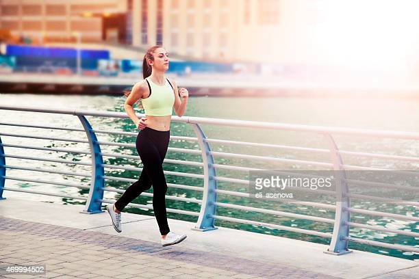 Woman jogging in Dubai Marina.