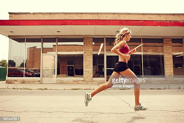 Woman jogging in street