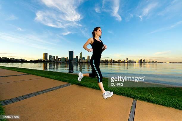 Woman Jogging infront Perth Skyline