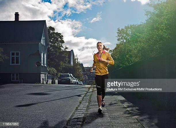 Woman jogging on city street