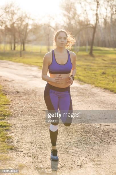 Woman jogging on dirt road