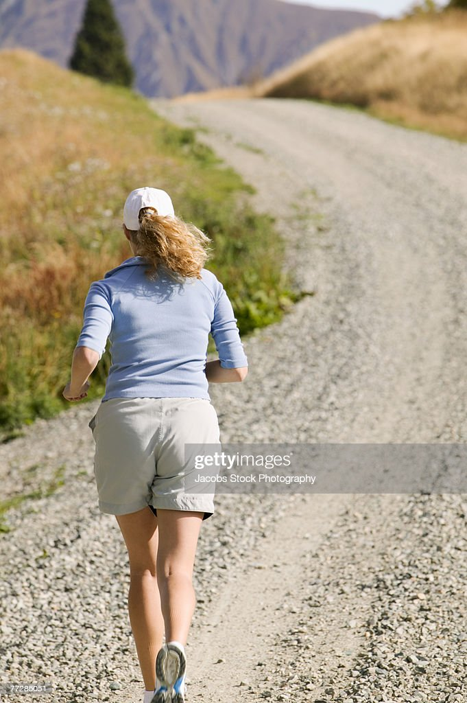 Woman Jogging At Mountain Royalty Free Stock Image - Image: 25933286