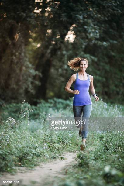 Woman Jogging on Nature Trail