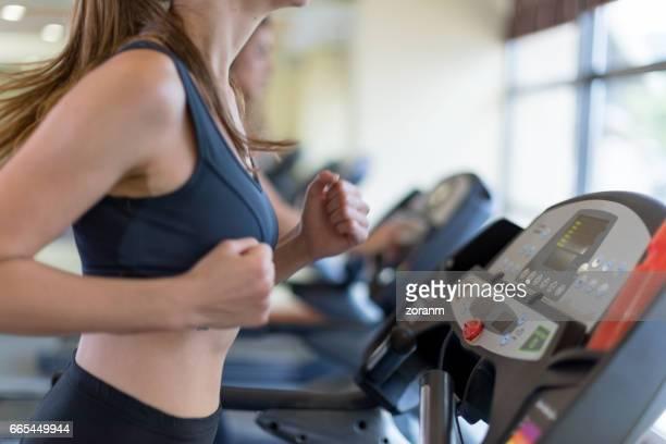 Woman jogging on treadmill