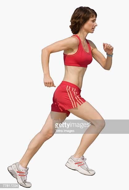 Woman jogging on urban sidewalk