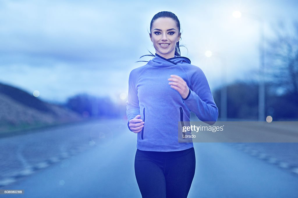 woman jogging outdoors in the evening : Stock Photo